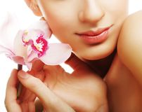 Young woman with pink orchid Stock Photos