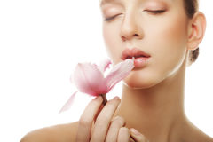 Young woman with pink orchid Royalty Free Stock Photography