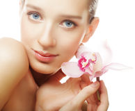 Young woman with pink orchid Royalty Free Stock Images