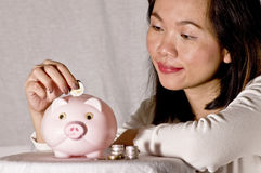 Young woman with pink piggy bank. Close up woman and piggy bank Royalty Free Stock Photo
