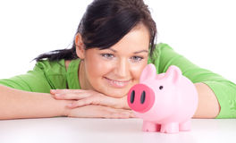 Young woman with pink piggy bank Stock Image