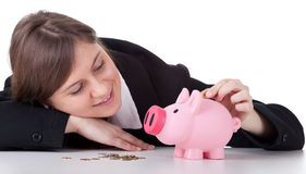 Young woman with pink piggy bank Stock Photography