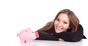 Young woman with pink piggy bank Stock Images