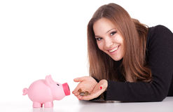 Young woman with pink piggy bank Royalty Free Stock Photo