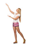 The young woman in pink plaid shorts isolated on white. Young woman in pink plaid shorts isolated on white Royalty Free Stock Images