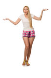 The young woman in pink plaid shorts isolated on white. Young woman in pink plaid shorts isolated on white Royalty Free Stock Photo