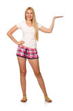 The young woman in pink plaid shorts isolated on white. Young woman in pink plaid shorts isolated on white Royalty Free Stock Photography