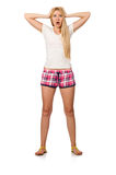 The young woman in pink plaid shorts isolated on white Stock Image
