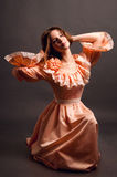Young woman in a pink retro dress Stock Images