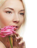 Young woman with pink rose Stock Images