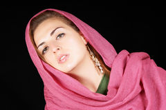 Young woman with pink scarf. Portrait of a beautiful young woman with pink scarf Stock Photo