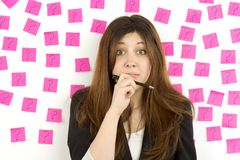 Young woman pink sticky notes question marks Stock Photography