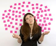 Young woman pink sticky notes question marks Stock Photos