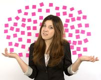 Young woman pink sticky notes question marks Royalty Free Stock Photos