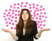 Young woman pink sticky notes question marks Stock Photo