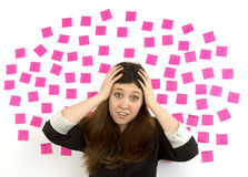 Young woman pink sticky notes question marks and h Royalty Free Stock Photos