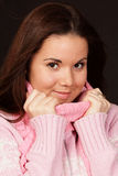 Young woman in pink sweater Stock Photo