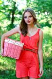 Young woman with pink vintage basket Royalty Free Stock Photography