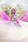Young woman among pink and white fabric Royalty Free Stock Photos