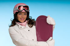 Young woman in pink and white winter outfit Stock Image