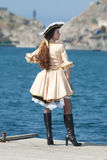 Young woman in pirate costume outdoors. Young woman in pirate costume on the pier Royalty Free Stock Photos