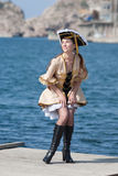 Young woman in pirate costume outdoors Stock Photos