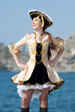 Young woman in pirate costume outdoors Stock Photo