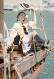 Young woman in pirate costume is posing Stock Images