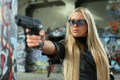 Young woman with pistol Royalty Free Stock Image
