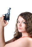 Young woman with a pistol stock image