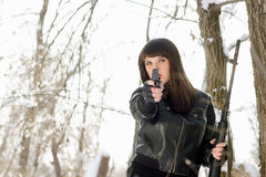 Young woman with a pistol stock photography