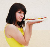 Young woman with pizza Stock Images