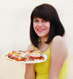 Young woman with pizza Royalty Free Stock Photos