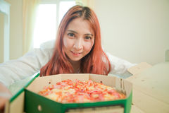 Young woman with pizza Royalty Free Stock Photo