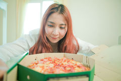 Young woman with pizza Royalty Free Stock Image