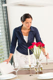Young woman placing candle table roses romantic Royalty Free Stock Image