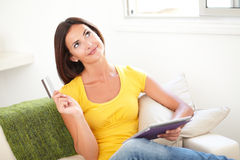 Young woman planning to make an electronic payment Royalty Free Stock Photos