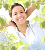 Young woman with plant. Young blond woman smiling with plant Royalty Free Stock Photo