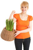 Young woman with plant in basket Royalty Free Stock Images