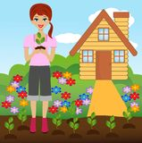 Young woman plant flower in soil Stock Image