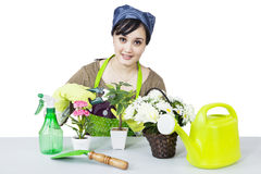 Young woman with plants - isolated Stock Photography