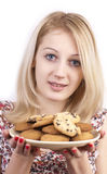 Young woman with plate of cookies. On white background royalty free stock photo