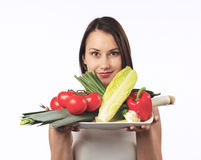 Young woman with a plate of fresh vegetables Royalty Free Stock Photography