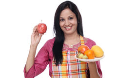 Young woman with plate of fruits Royalty Free Stock Image