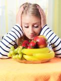 Young woman with a plate full of fruit. Royalty Free Stock Photo