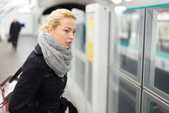 Young woman on platform of metro station. Royalty Free Stock Photography