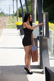 Young woman on platform of train station is looking for informat Stock Images