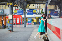 Young woman on the platform of a train station Royalty Free Stock Images