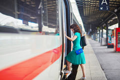 Young woman on the platform of a train station Royalty Free Stock Image