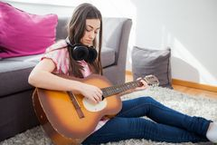 Young woman play acoustic guitar Royalty Free Stock Images